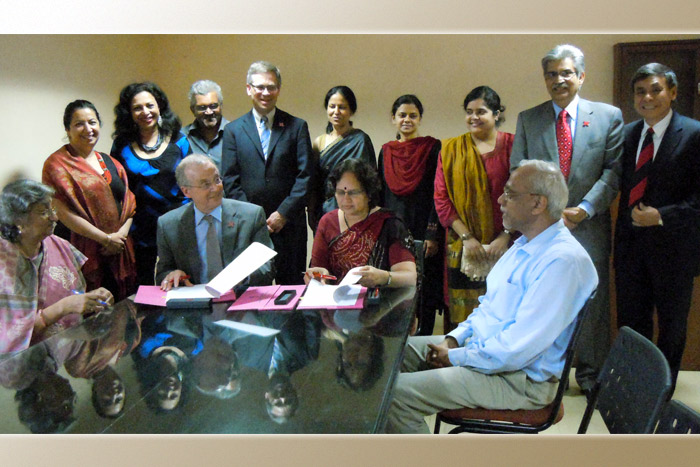 Chancellor Harvey Perlman signing an MOU with a delegation in India