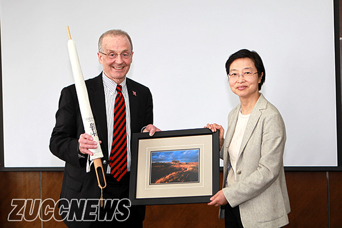Chancellor Perlman and ZUCC President Wu exchange gifts May 2013 in Hangzhou.