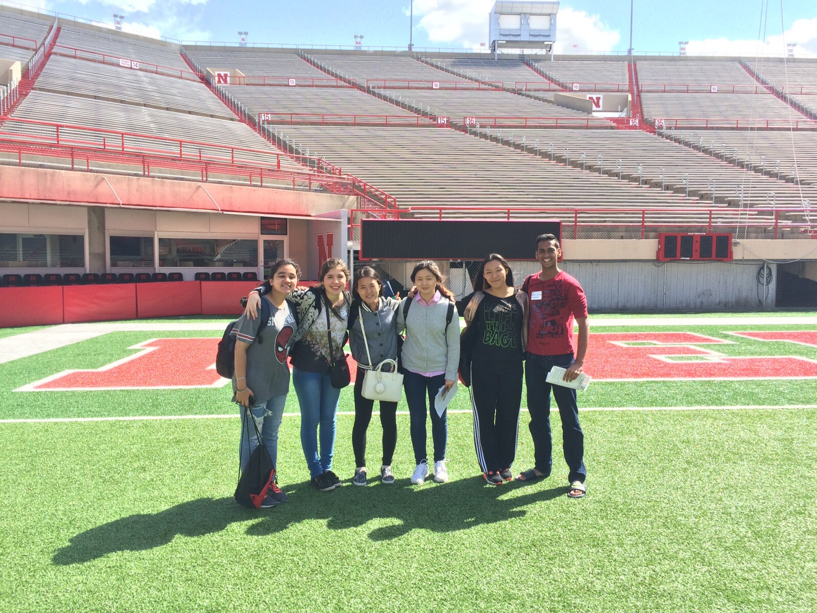 A group of new Fall 2015 international students who made a quick stop at the stadium during Undergraduate Orientation